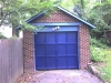 Blue-Trim Garage  Here you can see how we painted the detached-garage of this home in a color that complemented the home\'s overall color scheme.